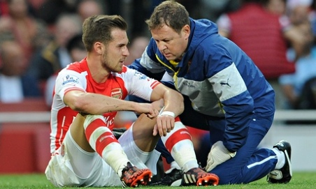 Aaron Ramsey down and out against Tottenham