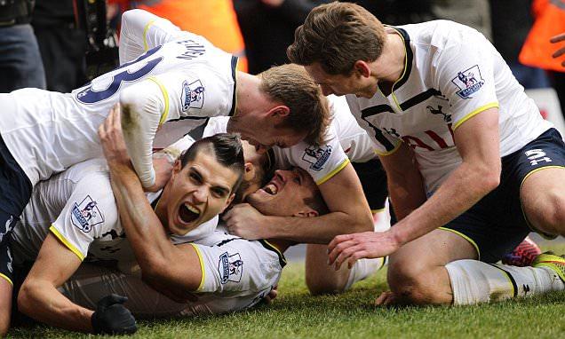 Harry Kane of Tottenham Hotspur celebrates scoring his sides second goal with team mates